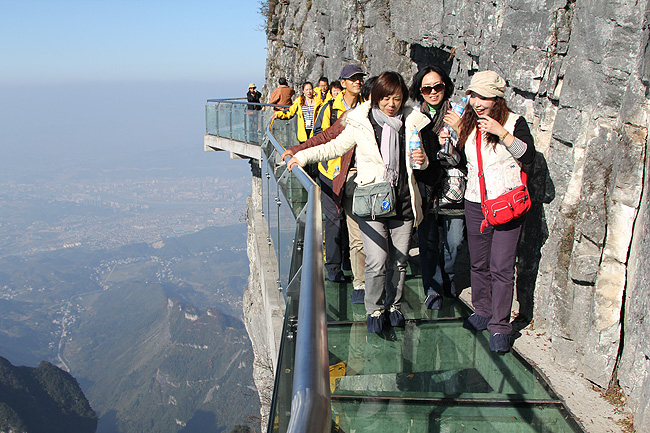 Is it crowded in Zhangjiajie? Should I book the hotel and ticket in advance?
