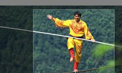 Chinese tightrope walkers at Aizhai briage